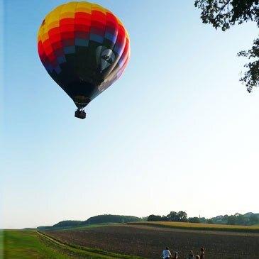 Baptême de l'air montgolfière en région Suisse